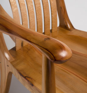 Close-up view of the armrest on our custom rocking chair, The South Yuba Rocking Chair, in Pacific Madrone