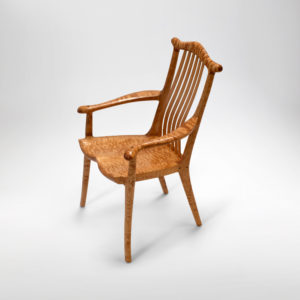Front angle view of the Poonkinny Chair, a custom design arm chair