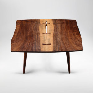 The Soojian Coffee Table hand-carved from California Walnut w/ hand-turned legs