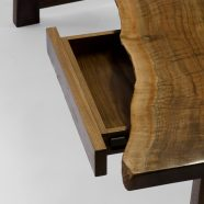 Hand-carved and set convenient drawers on The Lilienfeld Desk