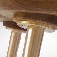 Close-up of the connection of the brass legs on our custom Van Muyden Side Chair