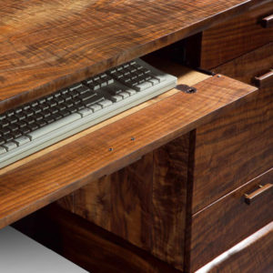 Hidden keyboard tray for ease of work on our hand-crafted Rockholt Desk