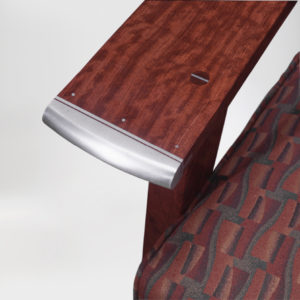 Close-up view of the custom brushed aluminum detail on our handcrafted Crane Chair w/ hand sewn upholstery