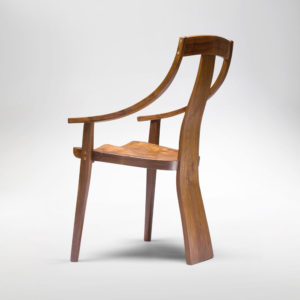 Side angle view of the Van Muyden Arm Chair, the first chair in the Erickson Bent Arm Collection