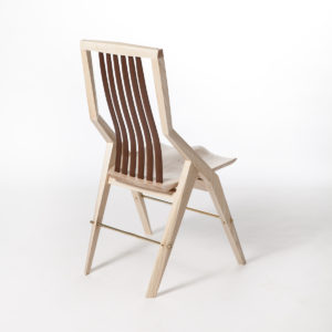 Rear angle shot of the handmade Reyes modern dining chair