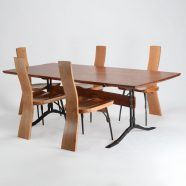 Our custom hand-carved Salin Dining Table set with The Salin Side Chair