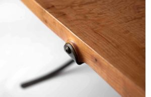 Close-up view of the top of the custom Sandhill Table w/ hand-forged iron accents