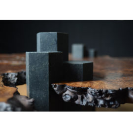 Close-up view of the hand-carved columnar basalt design on the legs of our custom Columnar Coffee Table