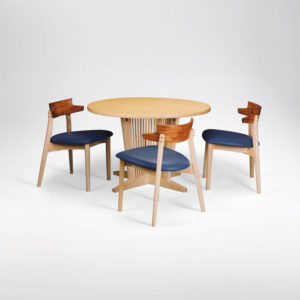 Arnold kitchen table and dining chairs made from bleached maple, African bubinga and custom upholstery