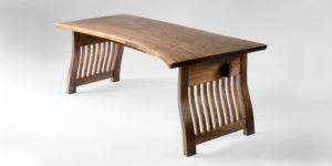 Rear angle view of our handmade Gilbert Desk, which features rustic live edges