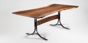 Our custom handmade Live Edge Table w/ hand-forged iron trestles