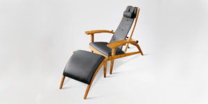 Our custom ergonomic Martinez Recliner w/ hand-sewn leather upholstery and foot stool