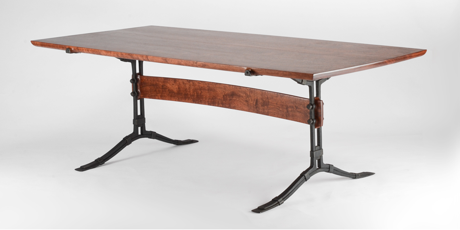 Our handmade Salin Trestle Table w/ hand-forged iron