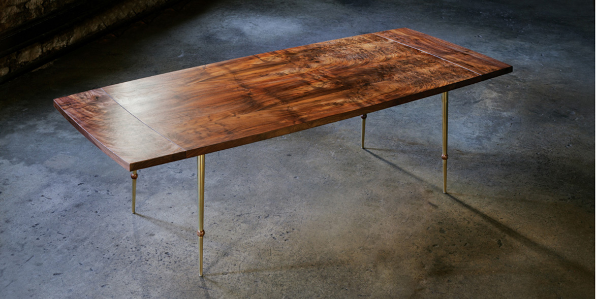 Des Tombe dining room table handcrafted from California walnut veneer
