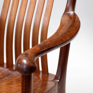 Close-up view of the curved armrest on our custom designed Poonkinny Chair