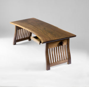 The custom-designed and hand-carved Lilienfeld office Desk