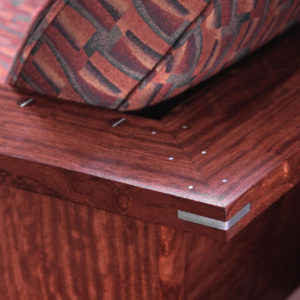 Close-up view of the custom brushed aluminum splines and pins on The Crane Chair