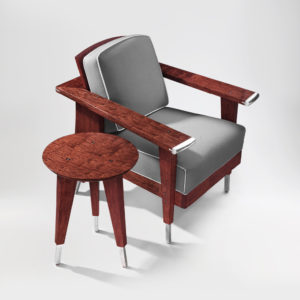 Front angle view of the Crane Upholstered Chair with custom bracketing and handmade upholstery