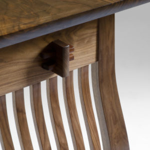 Hand-carved wooden connections on the spindle legs of The Lilienfeld Desk