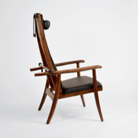 Side view of the handcrafted Kitkitdizze recliner with hand-stitched upholstery