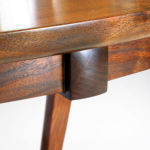 Close-up view of the handmade California Walnut fittings on our handcrafted Murdock Table for dining or gaming