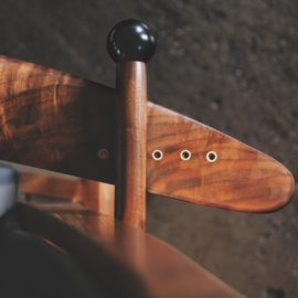 Close-up view of the handcrafted knob adjustment on the Kitkitdizze recliner with hand-forged knots