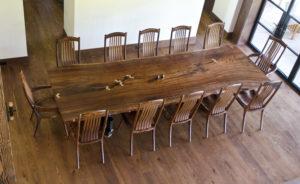 Handcrafted Filip Dining Table w/ basalt base designed for 12 people