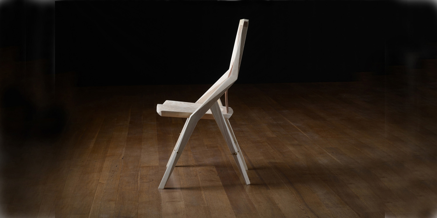 Side angle view of our handmade dining chair, the Reyes Chair