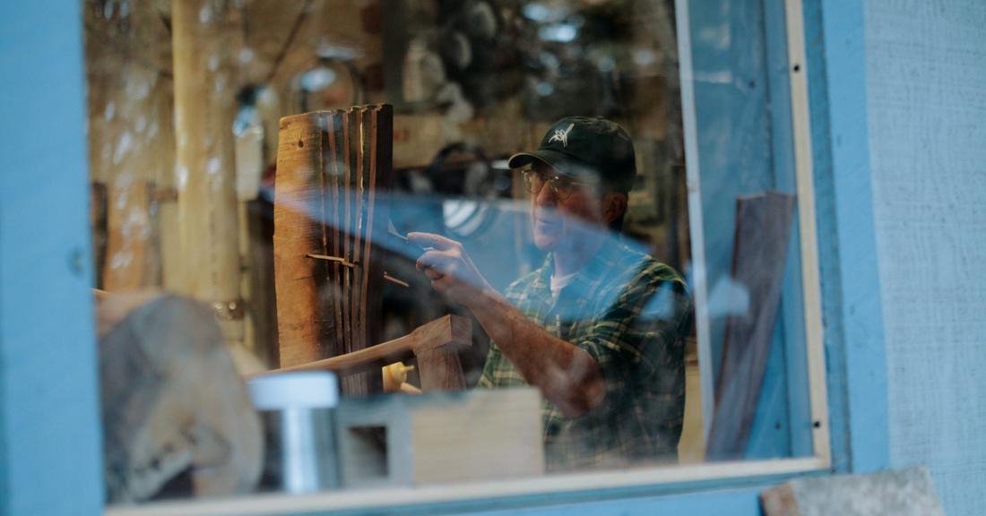 Custom woodworker Robert Erickson creating a unique live edge chair