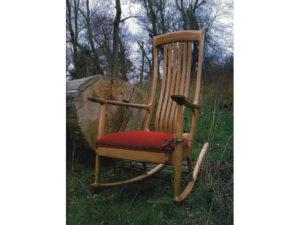 Upholstered handmade rocker in red elm