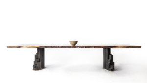 Custom handmade Filip dining table crafted from sourced California walnut w/ basalt base